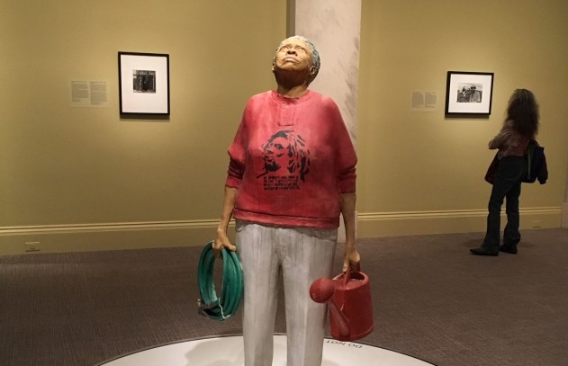 "The Gardener (Melissa with Bob Marley Shirt), by artist John Ahearn and sculptor Rigoberto Torres, is portrayed ""as someone who should be respected,"" the Portrait Gallery's note says."