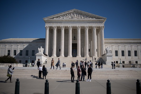 Visitors stand outside the U.S. Supreme Court in Washington, D.C., U.S., on Tuesday, Feb. 27, 2018.