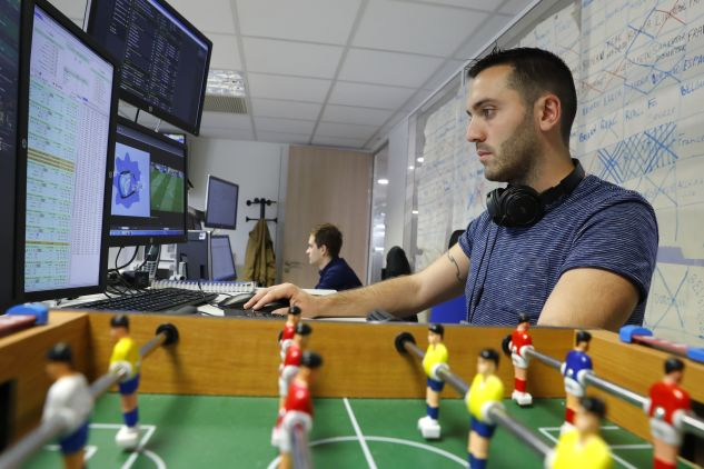 An employee of the online sports betting unit 'Parions Sports' (Let's Bet on Sports), a division of the 'Francaise des Jeux' (FDJ), the operator of France's national lottery games, monitors the live match betting odds during the Euro 2016 group E football match between Italy and Sweden, on June 17, 2016 in Boulogne -Billancourt, near Paris.
